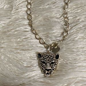 Tiger head necklace.